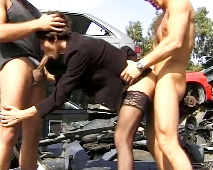 Porno Video of A German Slut Gets Double Teamed Outside In A Junk Car Lot