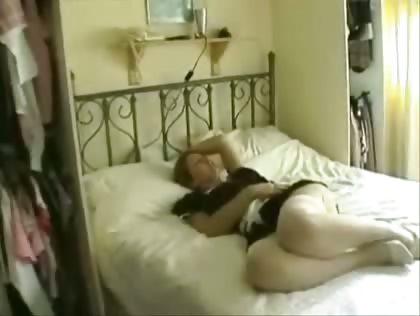 Porno Video of British Maid In White Fishnet Stockings Masturbating