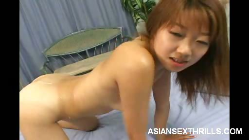 Porno Video of Sexy Asian Babe Spit Roasted