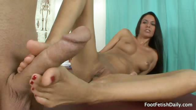 Porno Video of Nikki Wraps Her Sexy Toes Around A Cock And Gives A Footjob