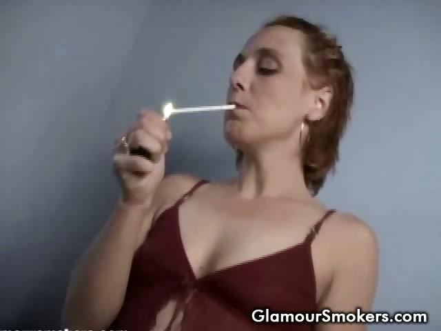 Porn Tube of Brunette Babe Smoking While Stripping Off Her Clothes