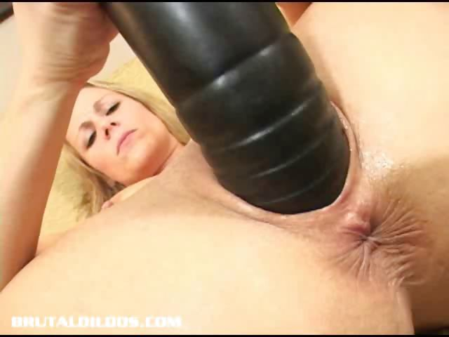 Porno Video of Sunny Stuffs Her Pussy With A Huge Dildo