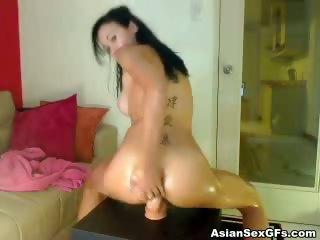 Porno Video of Oily Asian Hottie Riding A Fuck Machine