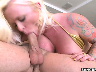slutty blonde babe angel treats his cock to a titty fuck with her massive gazongas
