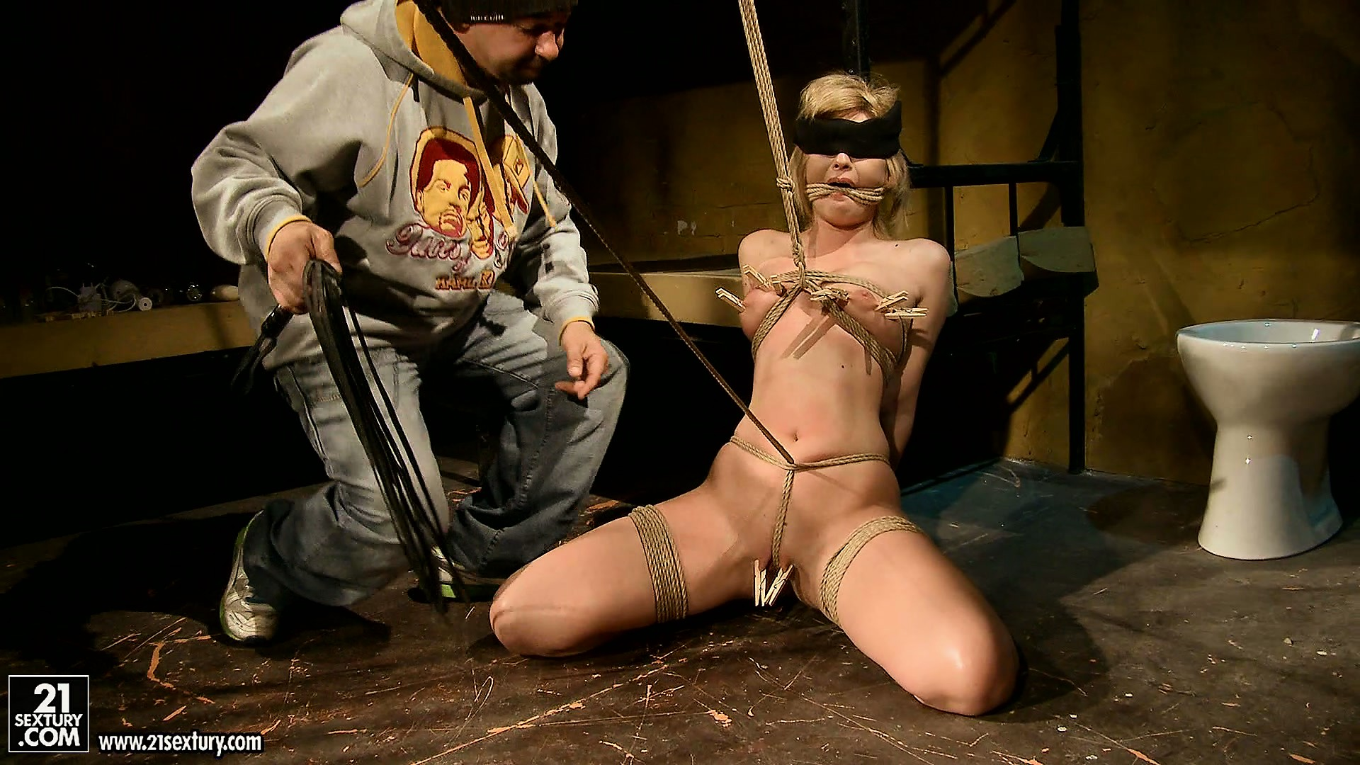 Porno Video of Blonde Is All Trussed Up And He Puts Clothespins All Over Her