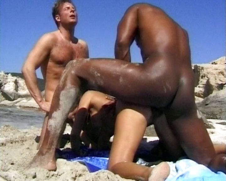 Porno Video of Short-haired Brunette Gets Herself Interracial Fucked By Two Guys