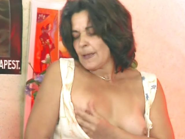 Porno Video of Mature German Hoochie Fucks Her Dark Hairy Cooch With A Toy