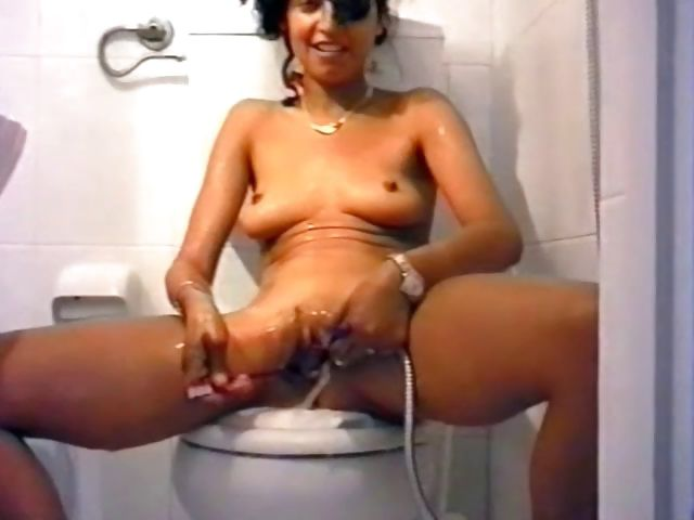 Porn Tube of Tanned German Teen Shaves Her Chocolate Pussy On The Toilet