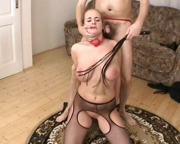 Sex Movie of Busty Blonde Slave In Crotchless Nylons Is On Her Knees Sucking