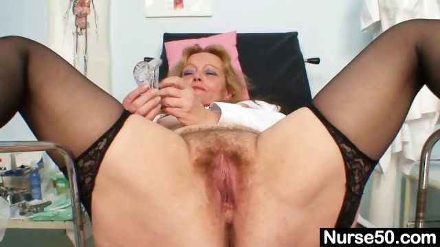 Sex Movie of Filthy Mature Lady Toys Her Hairy Pussy With Speculum