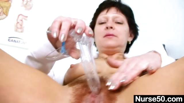 Porn Tube of Sexy Milf In Nurse Uniform Stretching Hairy Pussy