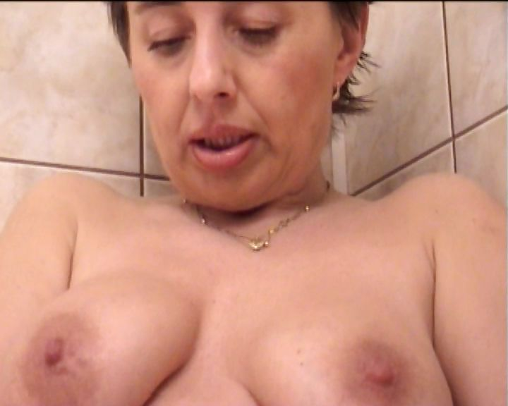 Porno Video of Hoochie Mama Fucks Her Mature Ass And Pussy In The Shower