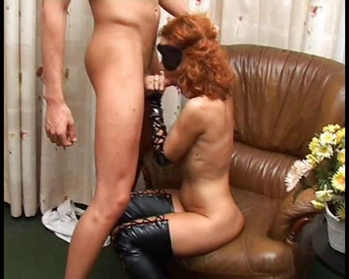 Porno Video of Redhead In Latex And A Mask Gets Two Cocks She Takes Care Of